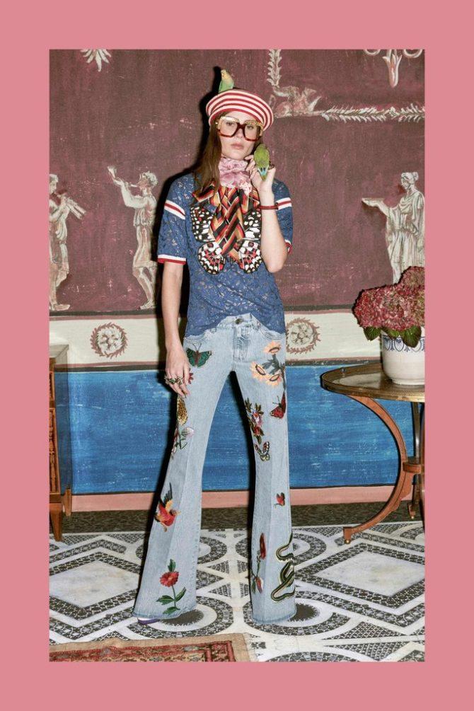 Модель в джинсах с аппликациями от Gucci